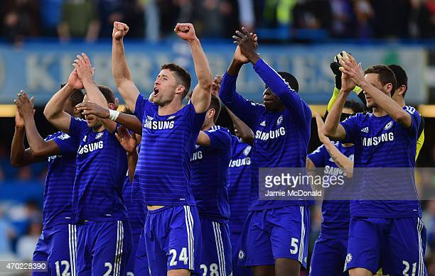 Branislav Ivanovic Gary Cahill and Kurt Zouma of Chelsea celebrate the 10 victory after the Barclays Premier League match between Chelsea and...