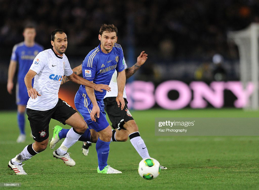 <a gi-track='captionPersonalityLinkClicked' href=/galleries/search?phrase=Branislav+Ivanovic&family=editorial&specificpeople=607152 ng-click='$event.stopPropagation()'>Branislav Ivanovic</a> of Chelsea and Danilo of Corinthians chase the ball during the FIFA Club World Cup Final Match between Corinthians and Chelsea at International Stadium Yokohama on December 16, 2012 in Yokohama, Japan.