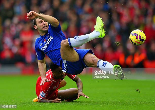 Branislav Ivanovic of Chelsea and Raheem Sterling of Liverpool battle for the ball during the Barclays Premier League match between Liverpool and...