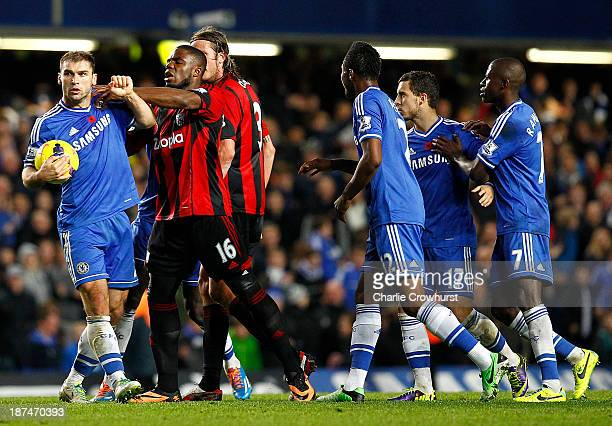 Branislav Ivanovic of Chelsea and West Brom's Victor Anichebe square up after Chelsea score a late equaliser during the Barclays Premier League match...