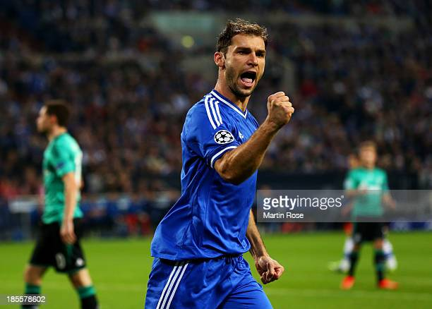 Branislav Ivanovic of Chelsea celebrates as Fernando Torres as he scores their first goal during the UEFA Champions League Group E match between FC...