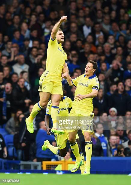 Branislav Ivanovic of Chelsea celebrates scoring his team's second goal with team mate Nemanja Matic during the Barclays Premier League match between...