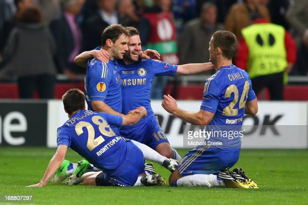 Branislav Ivanovic of Chelsea celebrates scoring their second and winning goal with Juan Mata Gary Cahill and Cesar Azpilicueta of Chelsea during the...