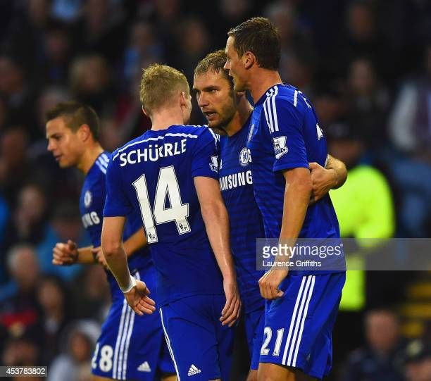 Branislav Ivanovic of Chelsea celebrates scoring their third goal with Andre Schurrle and Nemanja Matic of Chelsea during the Barclays Premier League...