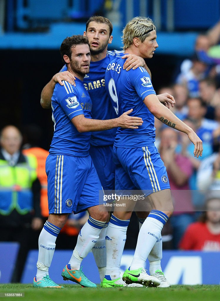 <a gi-track='captionPersonalityLinkClicked' href=/galleries/search?phrase=Branislav+Ivanovic&family=editorial&specificpeople=607152 ng-click='$event.stopPropagation()'>Branislav Ivanovic</a> of Chelsea (centre) celebrates with <a gi-track='captionPersonalityLinkClicked' href=/galleries/search?phrase=Juan+Mata&family=editorial&specificpeople=4784696 ng-click='$event.stopPropagation()'>Juan Mata</a> (L) and <a gi-track='captionPersonalityLinkClicked' href=/galleries/search?phrase=Fernando+Torres&family=editorial&specificpeople=194755 ng-click='$event.stopPropagation()'>Fernando Torres</a> (R) as he scores their fourth goal during the Barclays Premier League match between Chelsea and Norwich City at Stamford Bridge on October 6, 2012 in London, England.