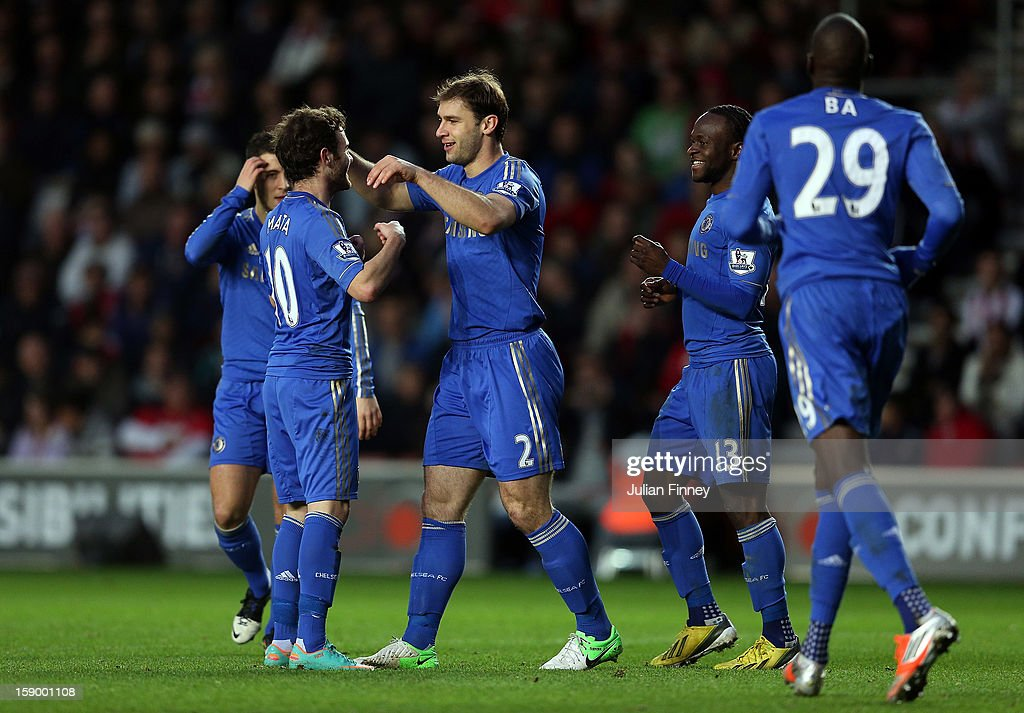 Branislav Ivanovic of Chelsea celebrates with Juan Mata of Chelsea and Victor Moses of Chelsea after he scored a header for their third goal during the FA Cup Third Round match between Southampton and Chelsea at St Mary's Stadium on January 5, 2013 in Southampton, England.