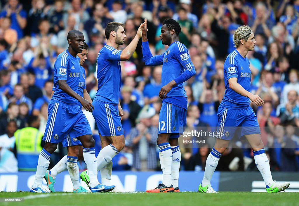 <a gi-track='captionPersonalityLinkClicked' href=/galleries/search?phrase=Branislav+Ivanovic&family=editorial&specificpeople=607152 ng-click='$event.stopPropagation()'>Branislav Ivanovic</a> of Chelsea (3L) celebrates with <a gi-track='captionPersonalityLinkClicked' href=/galleries/search?phrase=Mikel+John+Obi&family=editorial&specificpeople=4050358 ng-click='$event.stopPropagation()'>Mikel John Obi</a> (2R) as he scores their fourth goal during the Barclays Premier League match between Chelsea and Norwich City at Stamford Bridge on October 6, 2012 in London, England.