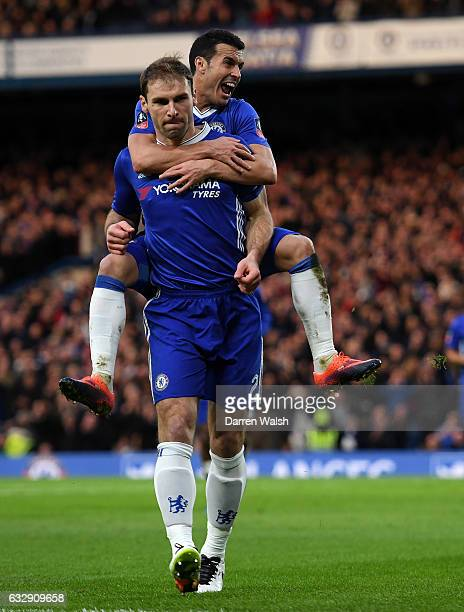 Branislav Ivanovic of Chelsea celebrates with Pedro of Chelsea after scoring his sides third goal the Emirates FA Cup Fourth Round match between...