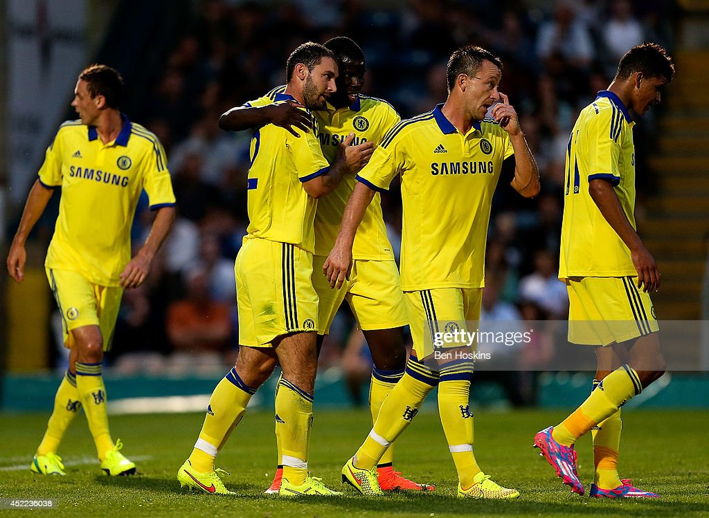 Branislav Ivanovic of Chelsea celebrates with team mates after scoring a goal duing the pre season friendly match between Wycombe Wanderers and Chelsea at Adams Park on July 16, 2014 in High Wycombe, England.