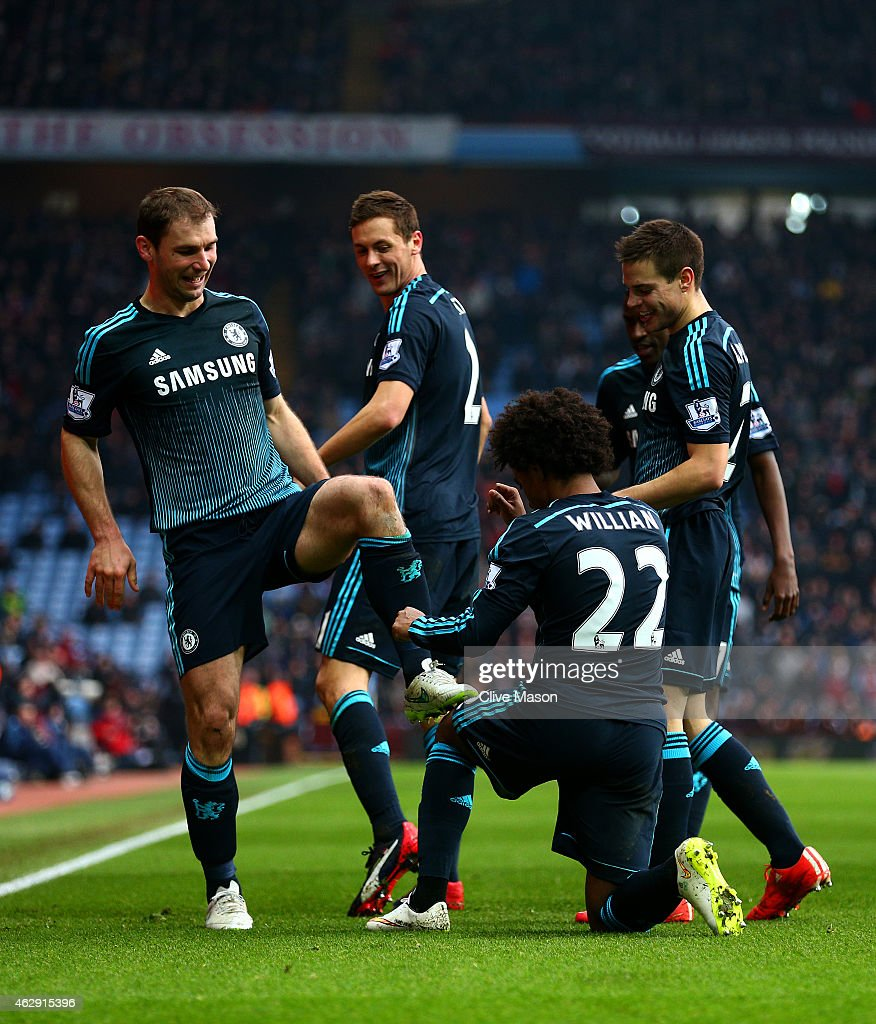 Branislav Ivanovic of Chelsea celebrates with team-mates after scoring his team's second goal during the Barclays Premier League match between Aston Villa and Chelsea at Villa Park on February 7, 2015 in Birmingham, England.