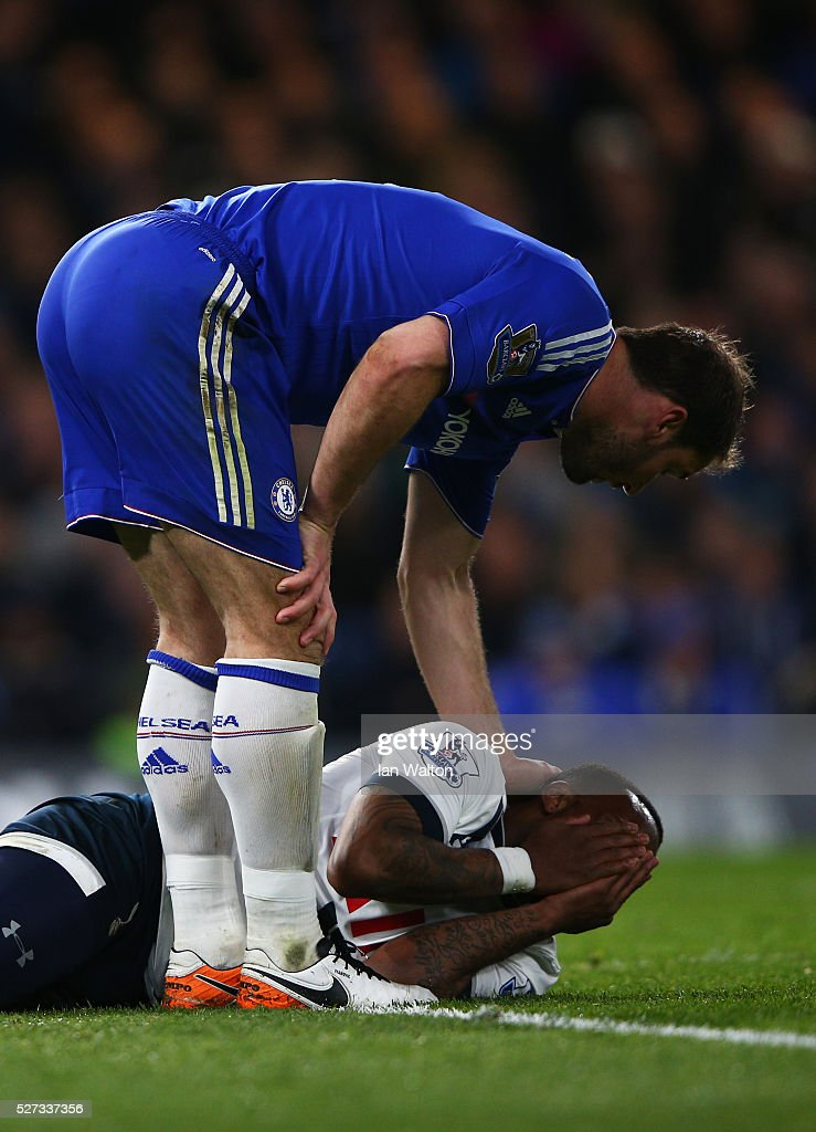 Branislav Ivanovic of Chelsea checks on the injured Danny Rose of Tottenham Hotspur during the Barclays Premier League match between Chelsea and Tottenham Hotspur at Stamford Bridge on May 02, 2016 in London, England.