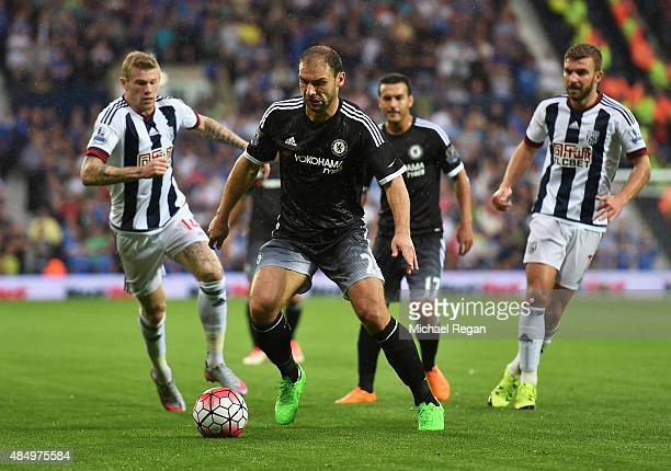 Branislav Ivanovic of Chelsea is closed down by James McClean and James Morrison of West Bromwich Albion during the Barclays Premier League match...