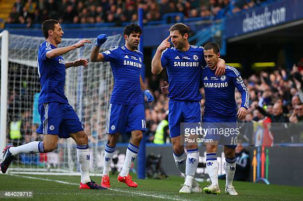 Branislav Ivanovic of Chelsea is congratulated by teammates after scoring the opening goal during the Barclays Premier League match between Chelsea...