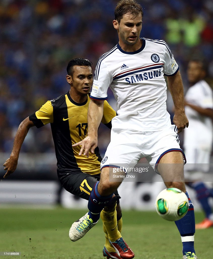 <a gi-track='captionPersonalityLinkClicked' href=/galleries/search?phrase=Branislav+Ivanovic&family=editorial&specificpeople=607152 ng-click='$event.stopPropagation()'>Branislav Ivanovic</a> of Chelsea is pursuit by Mohd Amri of Malaysia during the match between Chelsea and Malaysia XI on July 21, 2013 at the Shah Alam Stadium in Shah Alam, Kuala Lumpur, Malaysia.