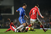 Branislav Ivanovic of Chelsea is tackled by Abou Diaby of Arsenal as Thomas Vermaelen of Arsenal closes him down during the Barclays Premier League...