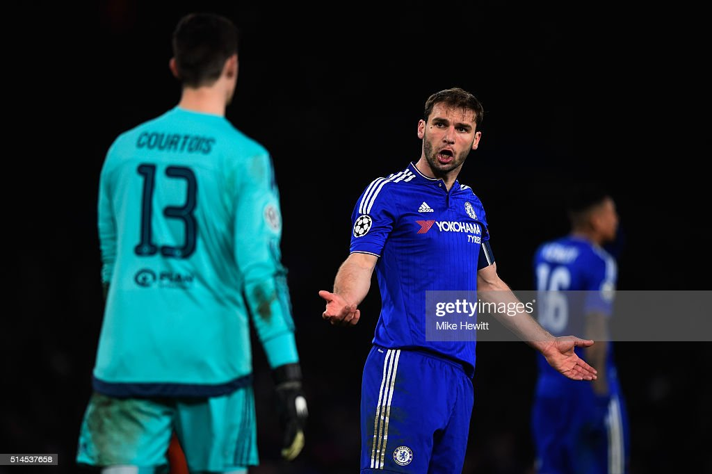 <a gi-track='captionPersonalityLinkClicked' href=/galleries/search?phrase=Branislav+Ivanovic&family=editorial&specificpeople=607152 ng-click='$event.stopPropagation()'>Branislav Ivanovic</a> of Chelsea remonstrates with goalkeeper <a gi-track='captionPersonalityLinkClicked' href=/galleries/search?phrase=Thibaut+Courtois&family=editorial&specificpeople=7126410 ng-click='$event.stopPropagation()'>Thibaut Courtois</a> of Chelsea during the UEFA Champions League round of 16, second leg match between Chelsea and Paris Saint Germain at Stamford Bridge on March 9, 2016 in London, United Kingdom.