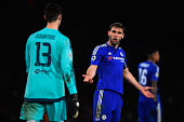 Branislav Ivanovic of Chelsea remonstrates with goalkeeper Thibaut Courtois of Chelsea during the UEFA Champions League round of 16 second leg match...