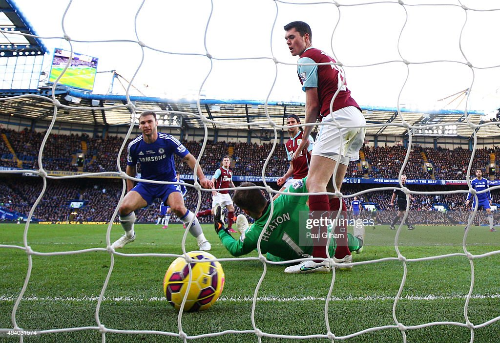 Branislav Ivanovic of Chelsea scores the opening goal past goalkeeper Thomas Heaton of Burnley during the Barclays Premier League match between Chelsea and Burnley at Stamford Bridge on February 21, 2015 in London, England.