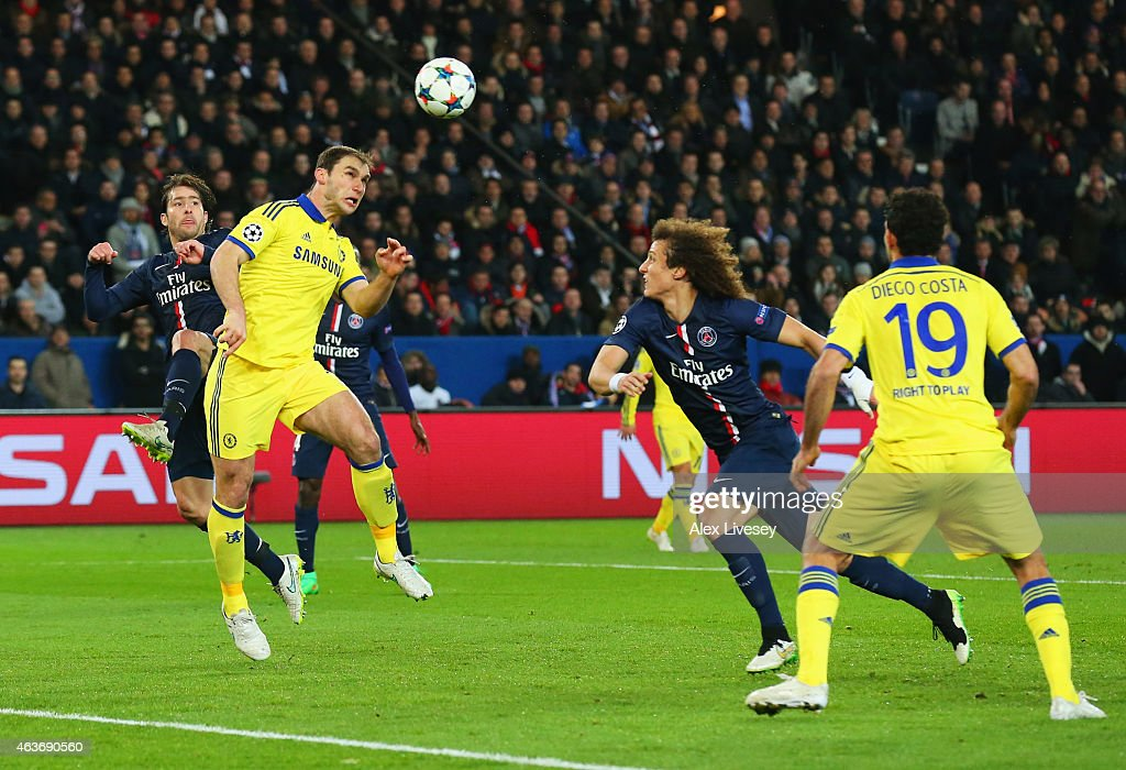<a gi-track='captionPersonalityLinkClicked' href=/galleries/search?phrase=Branislav+Ivanovic&family=editorial&specificpeople=607152 ng-click='$event.stopPropagation()'>Branislav Ivanovic</a> of Chelsea (2L) scores their first goal with a header during the UEFA Champions League Round of 16 match between Paris Saint-Germain and Chelsea at Parc des Princes on February 17, 2015 in Paris, France.