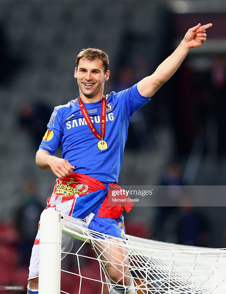 <a gi-track='captionPersonalityLinkClicked' href=/galleries/search?phrase=Branislav+Ivanovic&family=editorial&specificpeople=607152 ng-click='$event.stopPropagation()'>Branislav Ivanovic</a> of Chelsea sits on the goal cross bar as he celebrates victory during the UEFA Europa League Final between SL Benfica and Chelsea FC at Amsterdam Arena on May 15, 2013 in Amsterdam, Netherlands.
