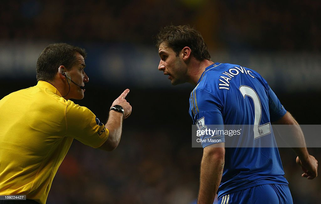Branislav Ivanovic of Chelsea talks to the assistant referee during the Capital One Cup Semi-Final first leg match between Chelsea and Swansea City at Stamford Bridge on January 9, 2013 in London, England.