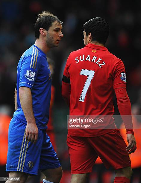 Branislav Ivanovic of Chelsea talks with Luis Suarez of Liverpool as they walk in for half time during the Barclays Premier League match between...