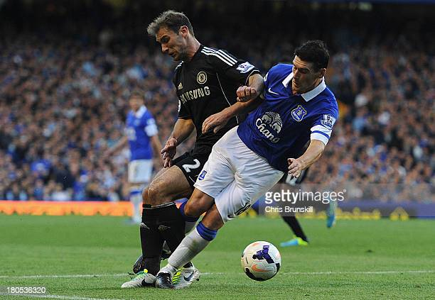 Branislav Ivanovic of Chelsea tangles with Gareth Barry of Everton during the Barclays Premier League match between Everton and Chelsea at Goodison...