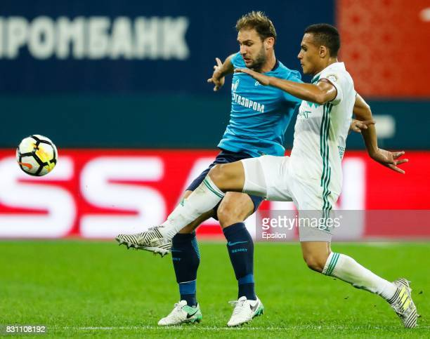 Branislav Ivanovic of FC Zenit Saint Petersburg and Leo Jaba of FC Akhmat Grozny vie for the ball during the Russian Football League match between FC...
