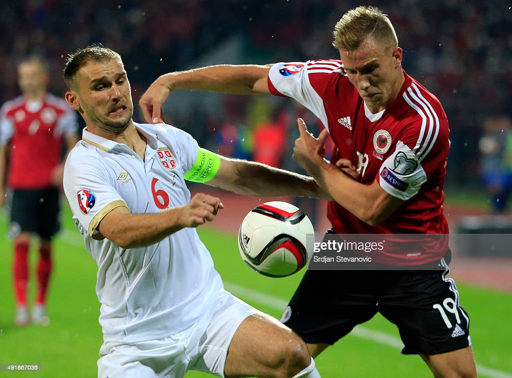 Branislav Ivanovic of Serbia competes for the ball with Bekim Balaj of Albania during the UEFA EURO 2016 qualifier between Albania and Serbia at the...