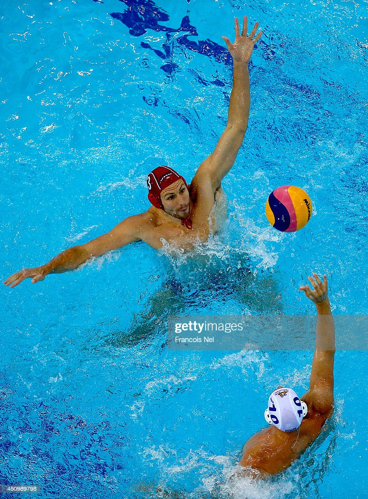 Branislav Mitrovic of Serbia makes a save against Denes Varga of Hungary during the Fina Men's Water Polo World League Super Final match between Hugary and Serbia at the Hamdan Sports Complex on June 21, 2014 in Dubai, United Arab Emirates.