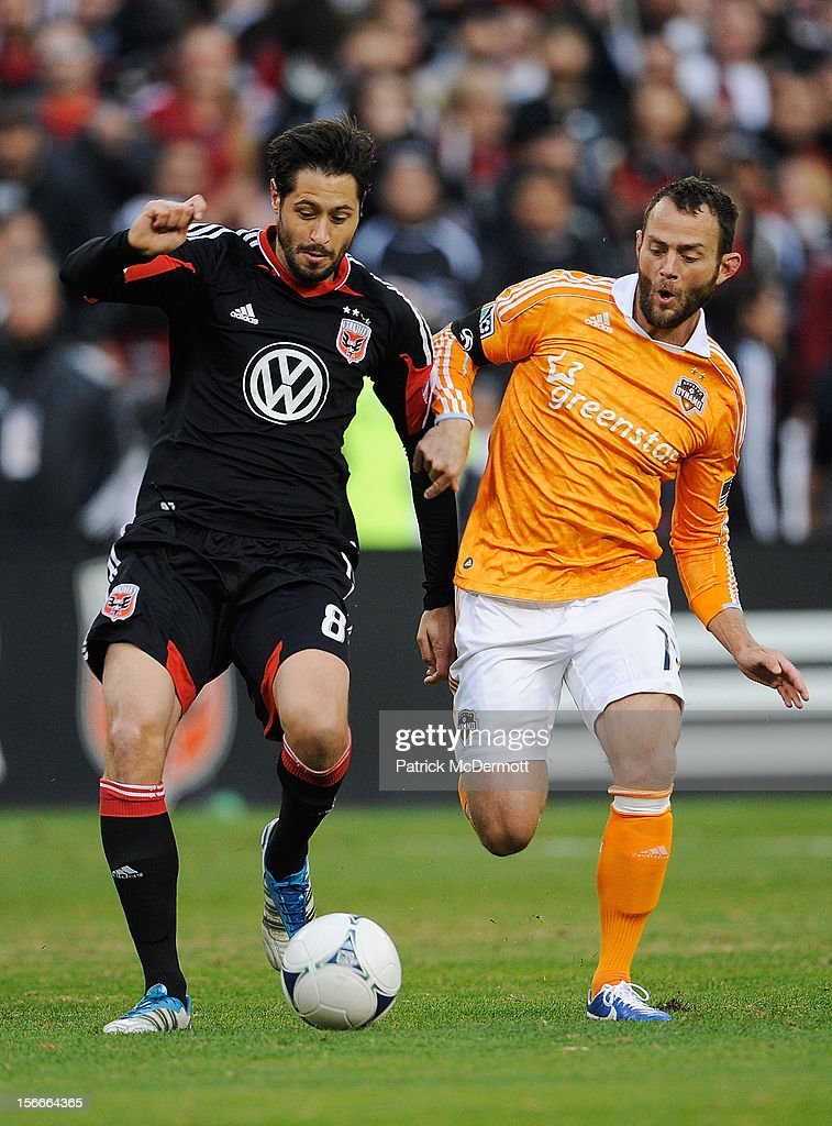 Branko Boskovic #8 of D.C. United battles for the ball against Brad Davis #11 of Houston Dynamo during leg 2 of the Eastern Conference Championship at RFK Stadium on November 18, 2012 in Washington, DC.