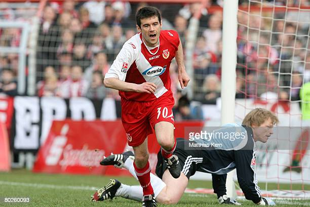 Branko Jelic of Cottbus jubilates after scoring the first goal as goalkeeper Oliver Kahn of Bayern reacts during the Bundesliga match between FC...