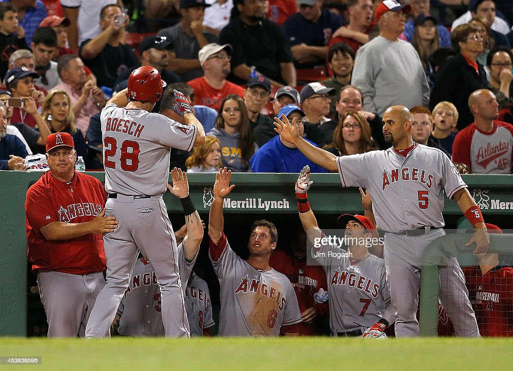 Brannan Boesch #28 of the Los Angeles Angels of Anaheim celebrates after he scored in the ninth inning against the Boston Red Sox at Fenway Park on August 19, 2014 in Boston, Massachusetts.