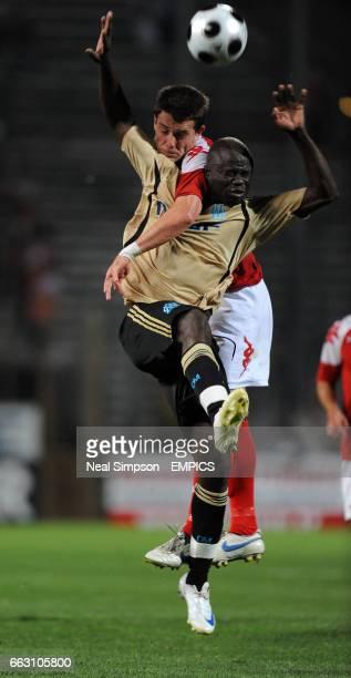 SK Brann's Gylfi Einarsson outjumps Olympique Marseille's Modeste M'Bami