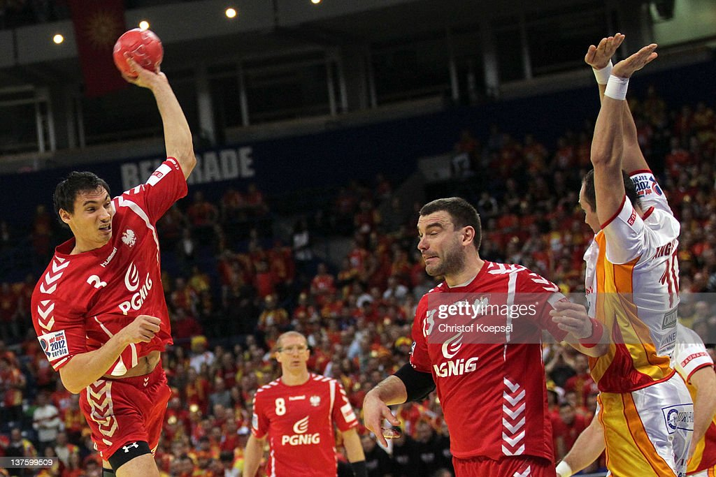 Bransilav Angelovski of Macedonia (R) defends against Krzysztof Lijewski of Poland (L) during the Men's European Handball Championship second round group one match between Poland and Macedonia at Beogradska Arena on January 23, 2012 in Belgrade, Serbia.