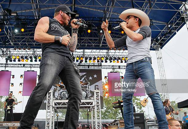 Brantley Gilbert and Justin Moore perform during day 2 of the Brickfest Music Festival at Indianapolis Motor Speedway on July 27 2014 in Indianapolis...
