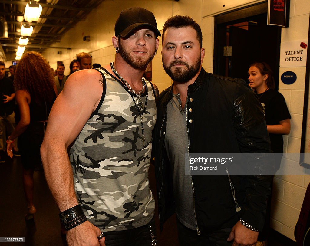 <a gi-track='captionPersonalityLinkClicked' href=/galleries/search?phrase=Brantley+Gilbert&family=editorial&specificpeople=7035830 ng-click='$event.stopPropagation()'>Brantley Gilbert</a> and <a gi-track='captionPersonalityLinkClicked' href=/galleries/search?phrase=Tyler+Farr&family=editorial&specificpeople=8377194 ng-click='$event.stopPropagation()'>Tyler Farr</a> attend the 2014 CMT Music Awards at Bridgestone Arena on June 4, 2014 in Nashville, Tennessee.