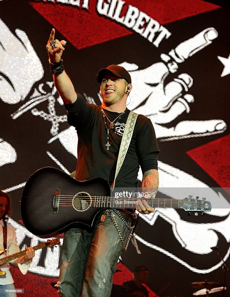 <a gi-track='captionPersonalityLinkClicked' href=/galleries/search?phrase=Brantley+Gilbert&family=editorial&specificpeople=7035830 ng-click='$event.stopPropagation()'>Brantley Gilbert</a> performs on stage as part of the Country 2 Country tour at O2 Arena on March 17, 2013 in London, England.