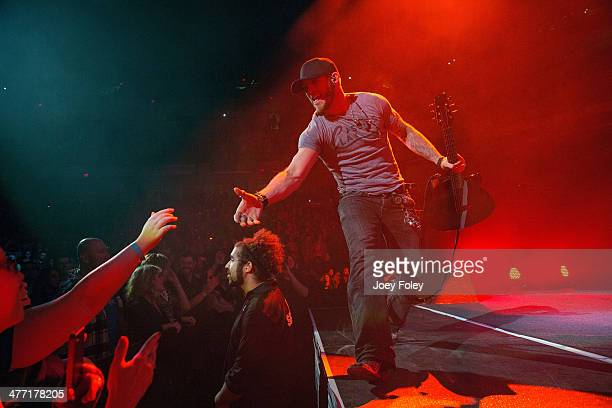 Brantley Gilbert performs onstage at Bankers Life Fieldhouse on February 15 2014 in Indianapolis Indiana