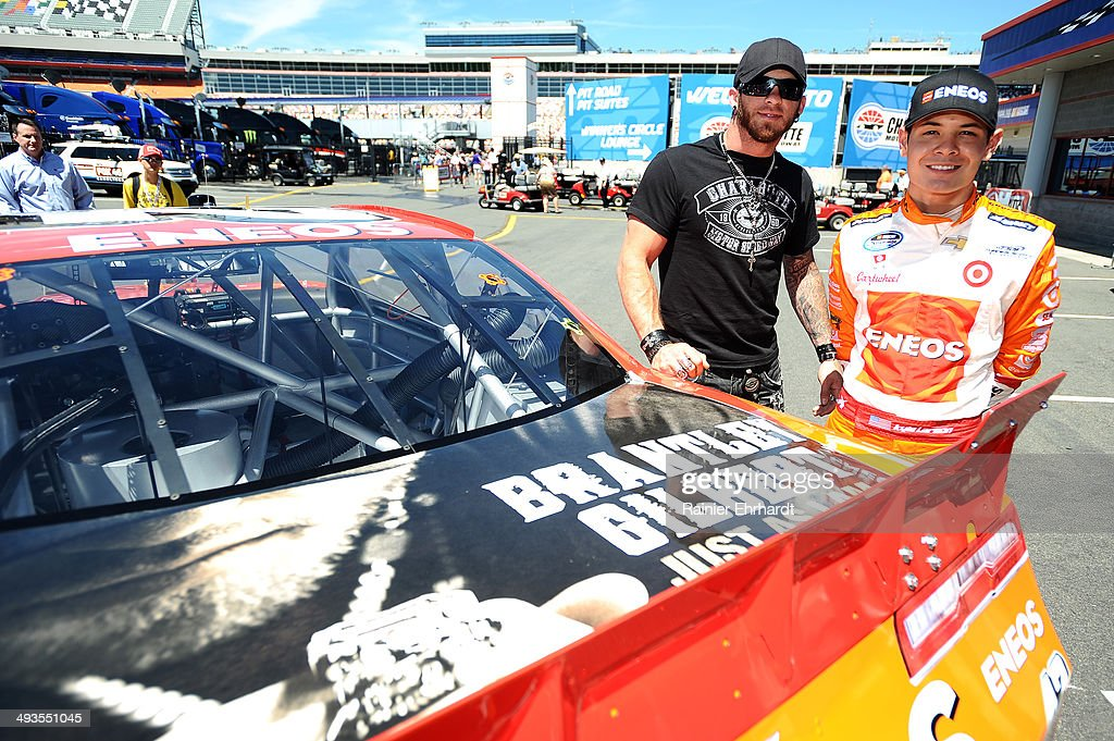 Brantley Gilbert (L), poses for a photo with driver Kyle Larson at Charlotte Motor Speedway on May 24, 2014 in Charlotte, North Carolina.