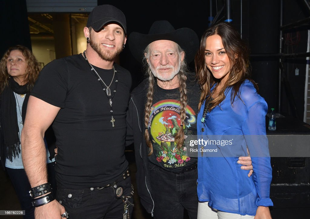 Brantley Gilbert, Willie Nelson, Jana Kramer backstage during Keith Urban's Fourth annual We're All For The Hall benefit concert at Bridgestone Arena on April 16, 2013 in Nashville, Tennessee.