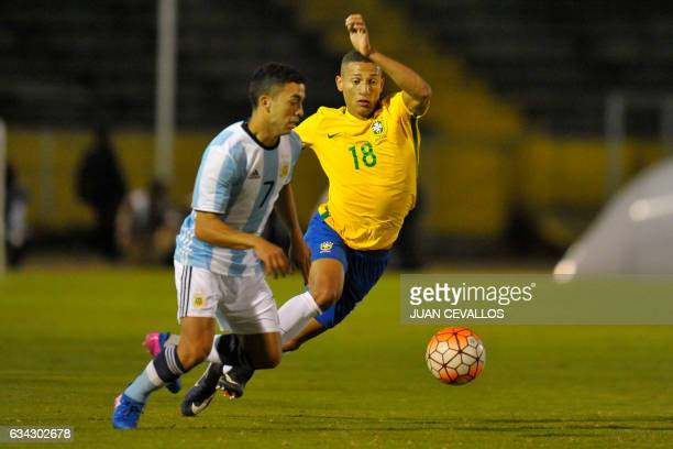 Brasil`s player Richarlison vies for the ball with Argentina`s player Lucas Rodríguez during a South American Championship U20 football match at the...