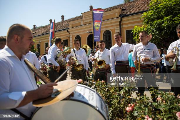 A brass band gathers in the town centre during the Guca Trumpet Festival on August 10 2017 in Guca Serbia Thousands of revellers attend the trumpet...