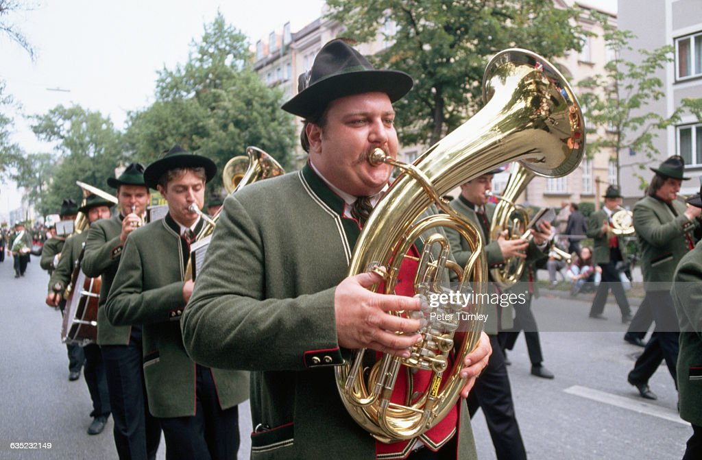 A brass band marches to the Oktoberfest grounds during the morning procession.