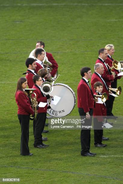 A brass band on the pitch before the match