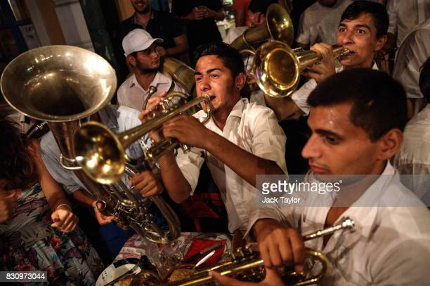 A brass band performs in a restaurant during the Guca Trumpet Festival on August 11 2017 in Guca Serbia Thousands of revellers attend the trumpet...