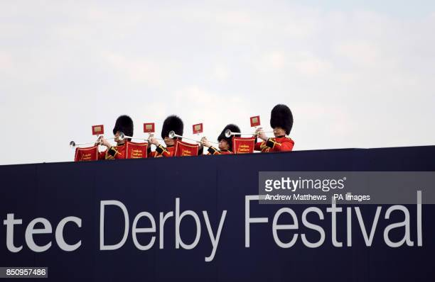 A Brass band plays at Epsom Downs Racecourse