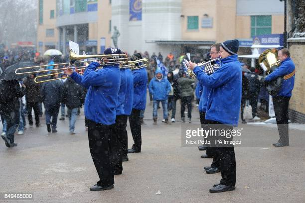 A brass band plays outside of Stamford Bridge before the match