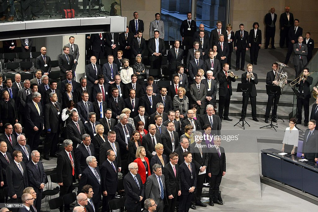 A brass band plays the national anthems of France and Germany to end a joint session of the German Bundestag and French Assemblee Nationale parliaments in the Reichstag building during the 50th anniversary celebration of the Elysee Treaty on January 22, 2013 in Berlin, Germany. The treaty, concluded in 1963 by Charles de Gaulle and Konrad Adenauer in the Elysee Palace in Paris, set a new tone of reconciliation between France and Germany, and called for consultations between the two countries to come to a common stance on policies affecting the most important partners in Europe as well as the rest of the region. Since its establishment, the document for improved bilateral relations has been seen by many as the driving force behind European integration.