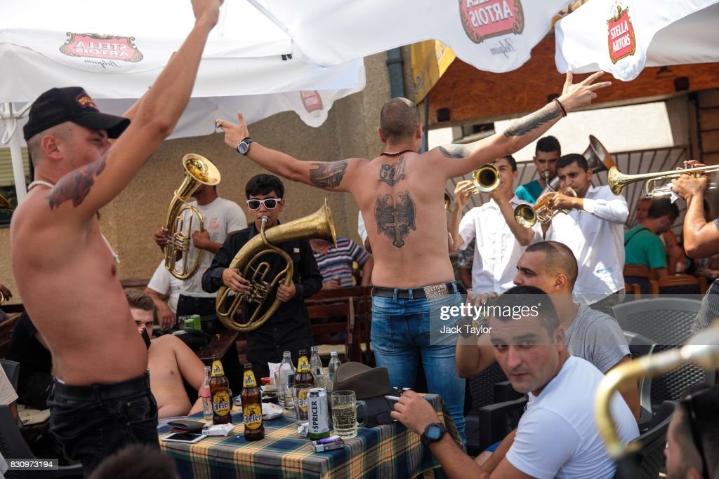 A brass band plays to revellers in a bar during the Guca Trumpet Festival on August 12, 2017 in Guca, Serbia. Thousands of revellers attend the trumpet festival, held annually since 1961 in the small, central Serbian town of Guca. The free event is a celebration of Balkan music with dozens of orchestras and solo trumpeters taking part in the festival's main competition. During the festival wild street parties take place throughout the night as brass bands parade and play for tips to the thousands of visitors in the town's restaurants, bars and pop-up tents.